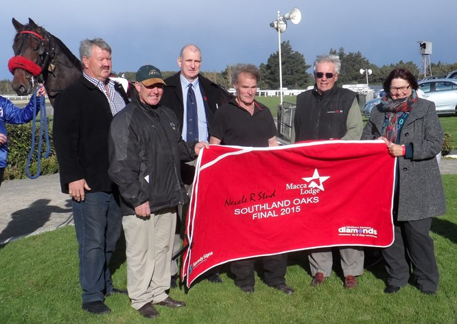 As co-sponsors of the Southland Oaks, Brent (with the cap) and Sheree McIntyre were on hand to make the presentation to the winner Smokin Bird's owner, Kevin Court.