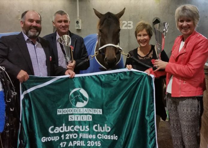 The spoils of success . . . Panspacificflight filly Arden's Choice with her owners after her Group I win last year